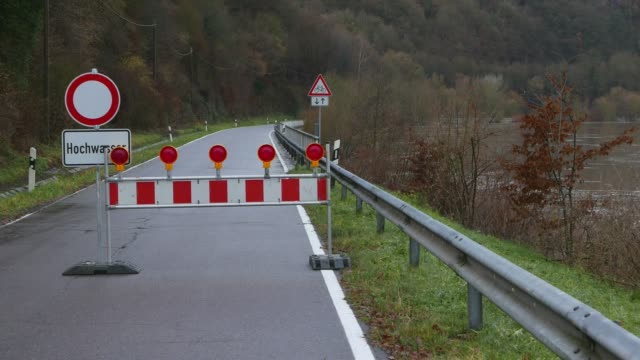 roadblock of a country road at flood, saar river, saar valley near staadt, rhineland-palatinate, germany - risk stock videos & royalty-free footage