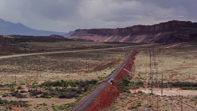 roads and train tracks through stunning utah landscape - drone shot - mesa stock videos and b-roll footage