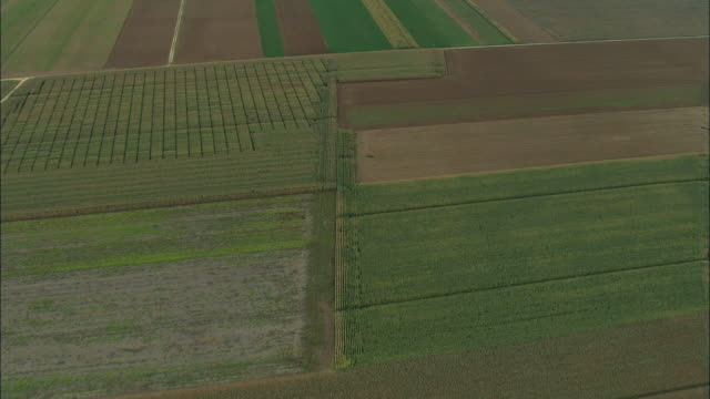 aerial ws roads winding through fields and rural landscape / rhone-alpes, france - rhone alpes stock videos & royalty-free footage