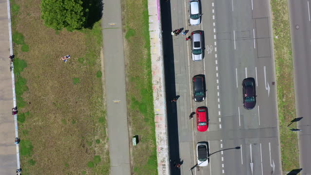 roadside of remains of the berlin wall / berlin, germany - symbols of peace stock videos & royalty-free footage