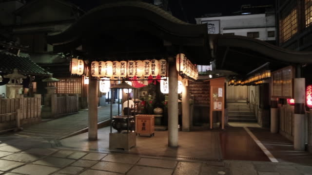 a roadside shrine nearby dotonbori shinto shrines can be seen everywhere in japan and shinto is the traditional local religion - shinto stock videos & royalty-free footage