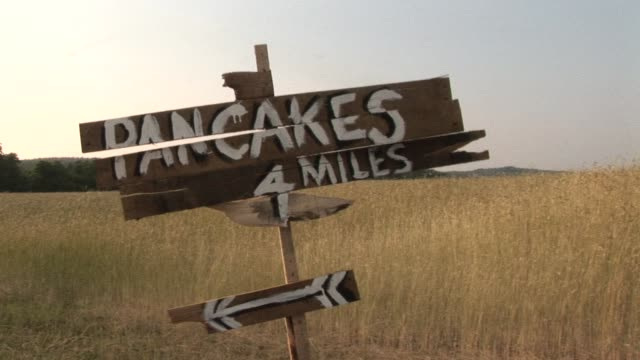 ms roadside sign for pancake stand shaking in the wind/ watermill, new york - roadside stock videos & royalty-free footage
