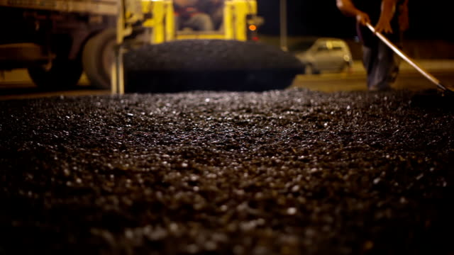 roadworks. asphalt paving - road construction stock videos and b-roll footage