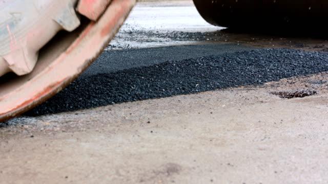 roadworks. asphalt spreader evens the road - roadworks stock videos & royalty-free footage
