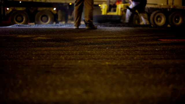 roadworks laying asphalt - road construction stock videos and b-roll footage