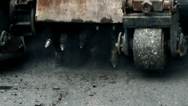 roadworks. rotary tiller grinding asphalt at part of road - russia stock videos & royalty-free footage