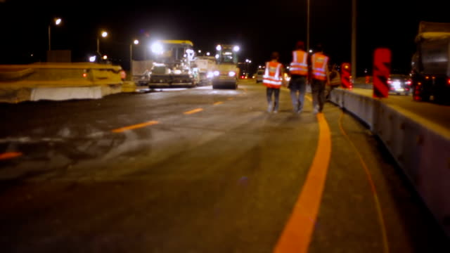 roadworks - workers on highway - installing stock videos and b-roll footage
