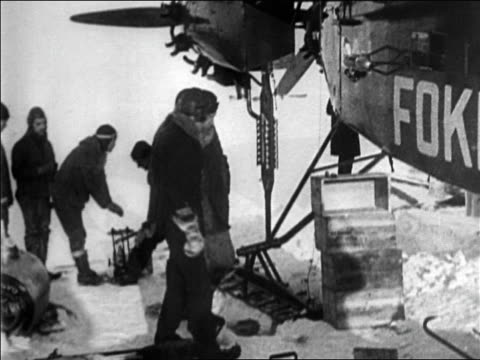 roald amundsen admiral byrd approaching airplane on snow / documentary - 1926 stock videos & royalty-free footage