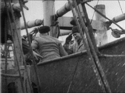 Roald Amundsen climbing onto boat shaking hands with Admiral Byrd / documentary