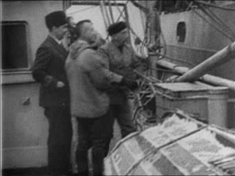 roald amundsen climbing up onto boat / documentary - 1926 stock videos & royalty-free footage