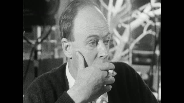 roald dahl smoking a cigarette and looking deep in thought while on the set of 'you only live twice' in 1967, - balding stock videos & royalty-free footage