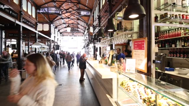 roaming shot of interior of mercado san miguel, madrid, spain, europe - spanish culture stock videos & royalty-free footage