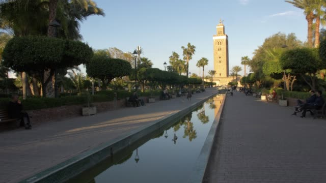 roaming shot of koutoubia minaret, unesco world heritage site, marrakech, morocco, north africa, africa - circa 12th century stock videos and b-roll footage