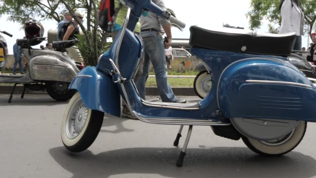 roaming shot of vintage mopeds at spring festival, funchal, madeira, portugal, europe - stationary stock videos & royalty-free footage