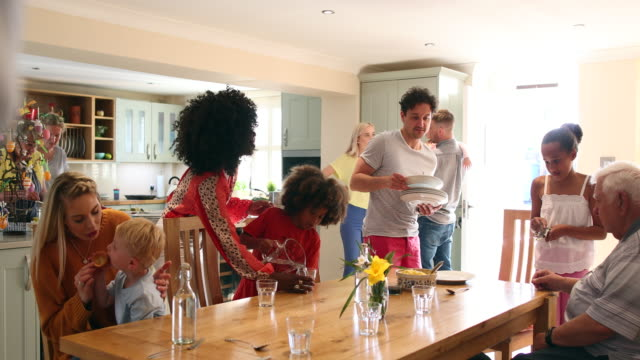 roast dinner preperations with family - dining table stock videos & royalty-free footage