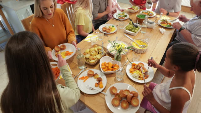 roast dinner time! - dining table stock videos & royalty-free footage