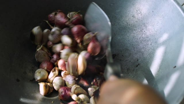 roast onion and garlic in pan - garlic stock videos & royalty-free footage