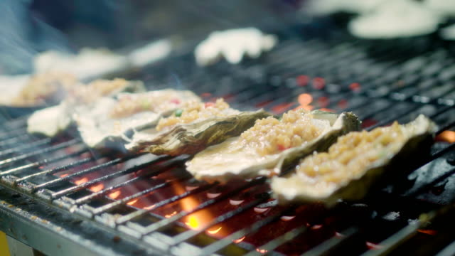 roast oysters sold at night market - crustacean stock videos & royalty-free footage
