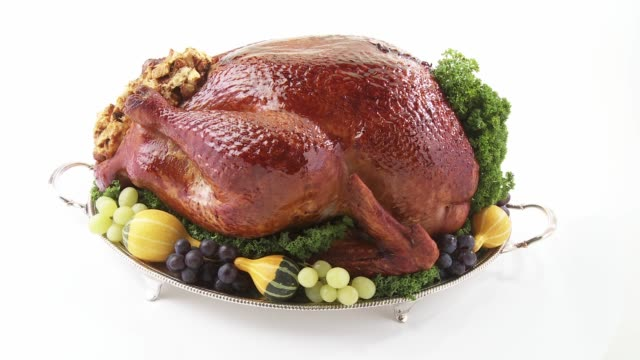 roast turkey with autumn decorations on silver platter - silver platter stock videos and b-roll footage