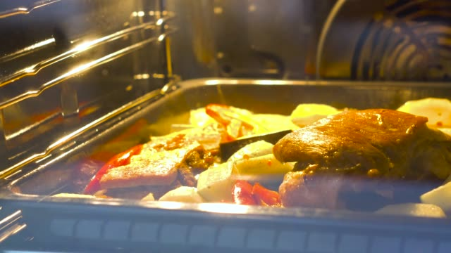 roast with vegetables in the oven - oven stock videos & royalty-free footage