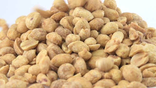 roasted and salted peanut falling in slow motion - crunchy stock videos & royalty-free footage