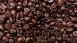 Roasted Arabica Coffee Beans Moving Down (2 Clips)
