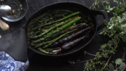 Roasted Asparagus and Purple Carrots in Cast Iron Skillet.