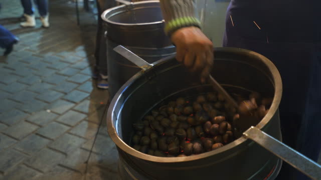 roasted chestnuts at winter in the street. - roasted stock videos & royalty-free footage