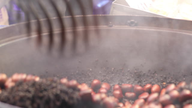 roasted chestnuts in machine - etnia video stock e b–roll