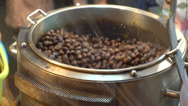 roasted chestnuts - traditionally portuguese stock videos and b-roll footage