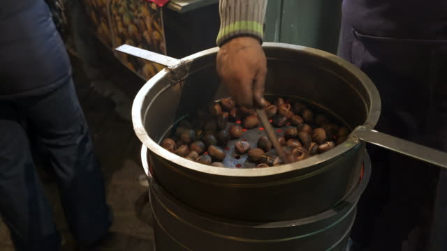 roasted chestnuts. - romania stock videos and b-roll footage