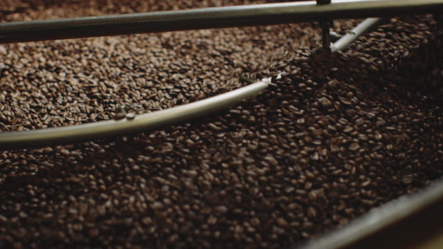 roasted coffee beans getting stirred in container - coffee drink stock videos & royalty-free footage