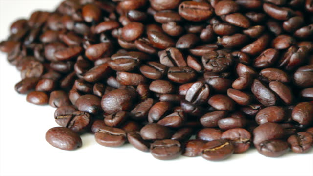 roasted coffee beans turning on a display - coffee drink stock videos & royalty-free footage