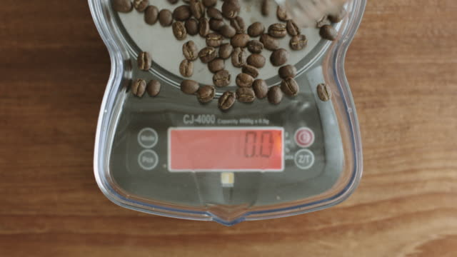 roasted coffee beans weighed on a scale - scales stock videos & royalty-free footage