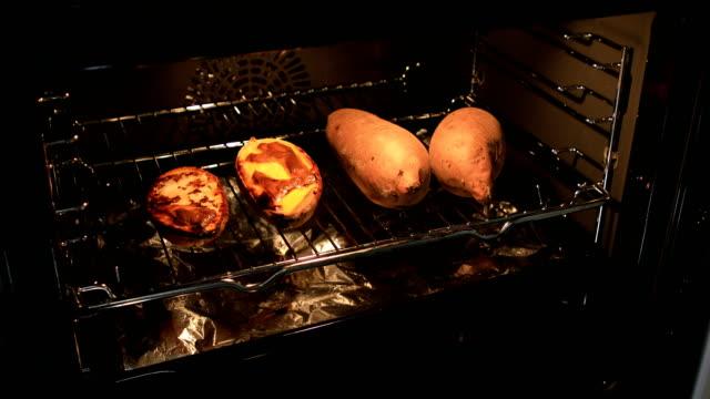 roasted sweet potatoes - sweet potato stock videos & royalty-free footage