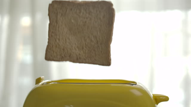roasted toast bread popping up from toaster - toaster appliance stock videos & royalty-free footage