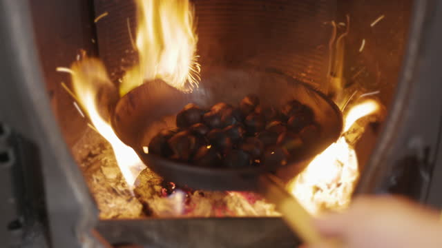 roasting chestnuts on a fireplace - soft focus stock videos & royalty-free footage
