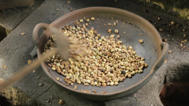 roasting coffee beans in bali, indonesia - balinese culture stock videos & royalty-free footage