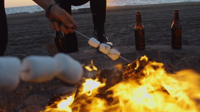 roasting s'mores - personal pov - camp fire stock videos & royalty-free footage