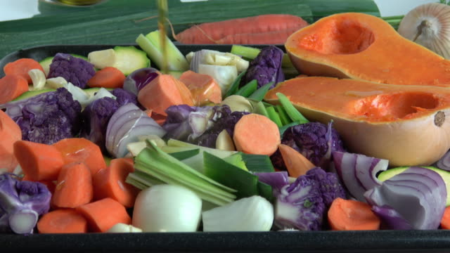 roasting vegetables - composite image stock videos & royalty-free footage