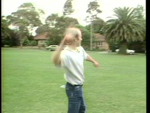 vidéos et rushes de rob krull throws his boomerang in the park. - boomerang