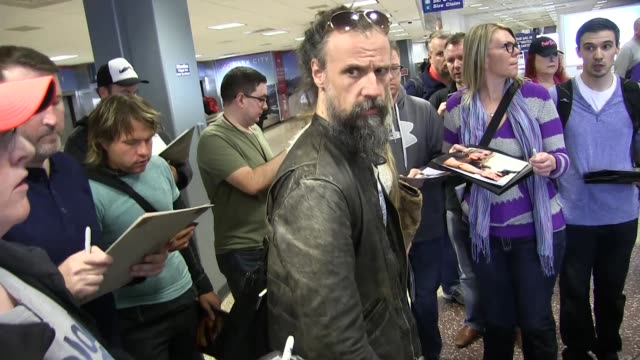 rob zombie and sheri moon zombie arrive at salt lake city international airport for the sundance film festival on january 22 2016 in salt lake city... - rob zombie stock videos & royalty-free footage