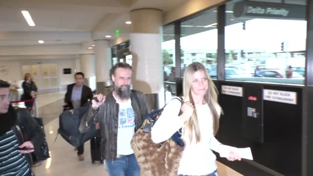 rob zombie and sheri moon zombie at los angeles international airport at celebrity sightings in los angeles on january 22 2016 in los angeles... - rob zombie stock videos & royalty-free footage