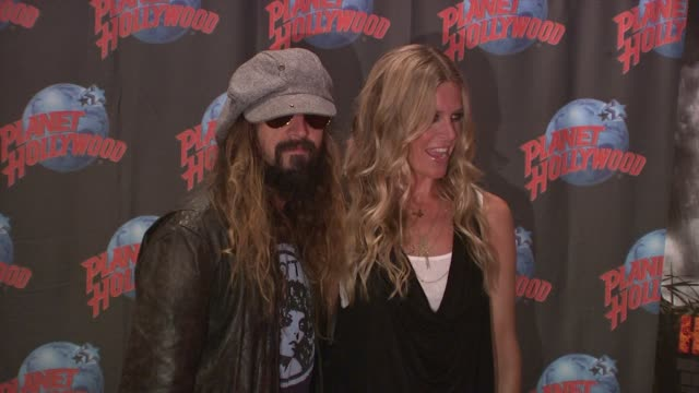 Rob Zombie and Sheri Moon Zombie at the Rob Zombie Sheri Moon Zombie Donate Memorabilia at Planet Hollywood at New York NY