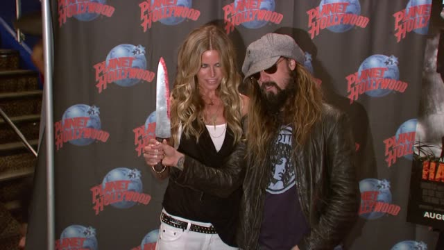 Rob Zombie Sheri Moon Zombie Donate Memorabilia at Planet Hollywood New York NY 8/18/09