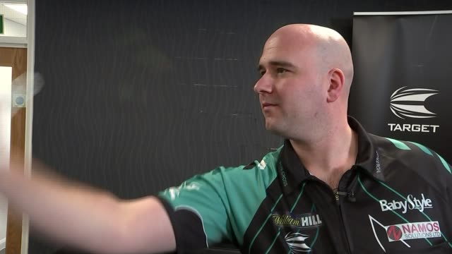 Robb Cross beats Phil Taylor to become World Champion Robb Cross throwing darts Darts hitting board