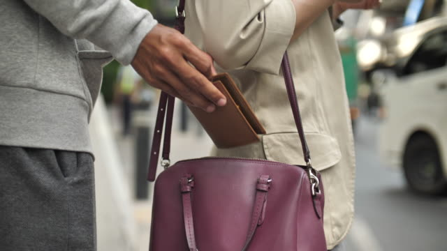 robber stealing woman bag in the street, close-up - stealing stock videos & royalty-free footage