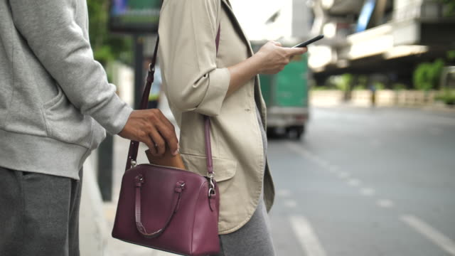 Robber stealing woman bag in the street, Close-up