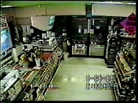 / robber wants to rob convenience store but realizes he needs a disguise, so he goes into the store's dumpster and finds a see through, transparent,... - man made object stock videos & royalty-free footage