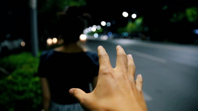 robber's hand behind a girl at night street - danger stock videos & royalty-free footage